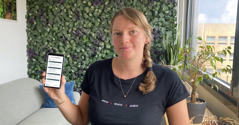 Employee with HR-ONs onboarding checklist on her phone
